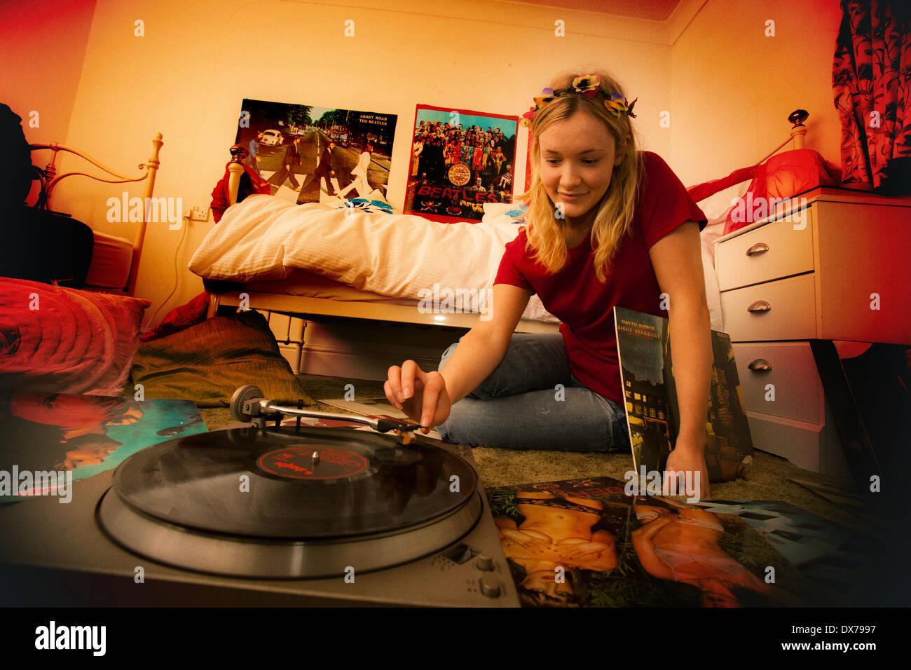 Pretty Teenage Girl In Her Bedroom Enjoying Her Vinyl