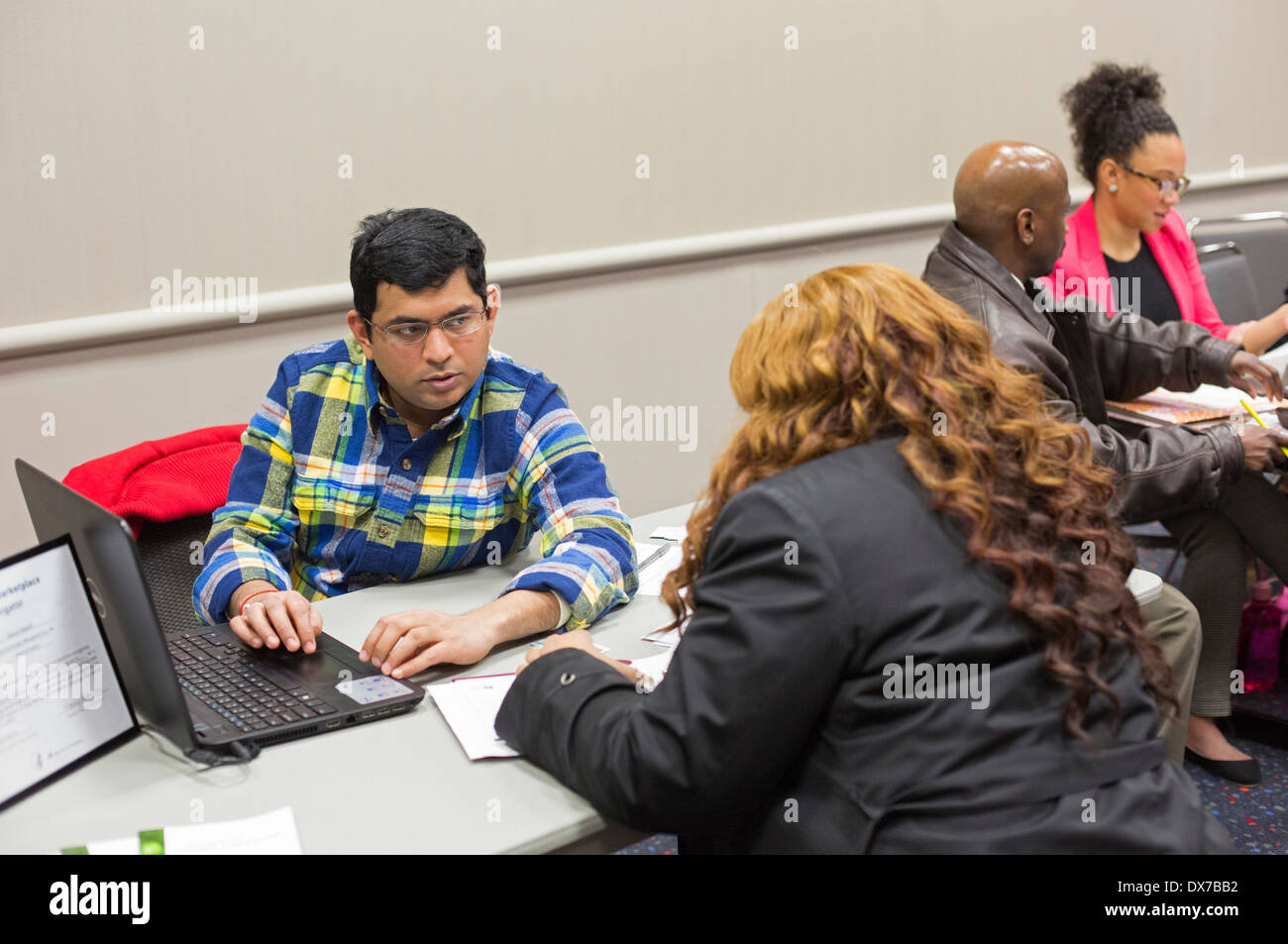 Detroit, Michigan - Health care 'navigators' sign people up for health insurance plans under the Affordable Care Act. - Stock Image