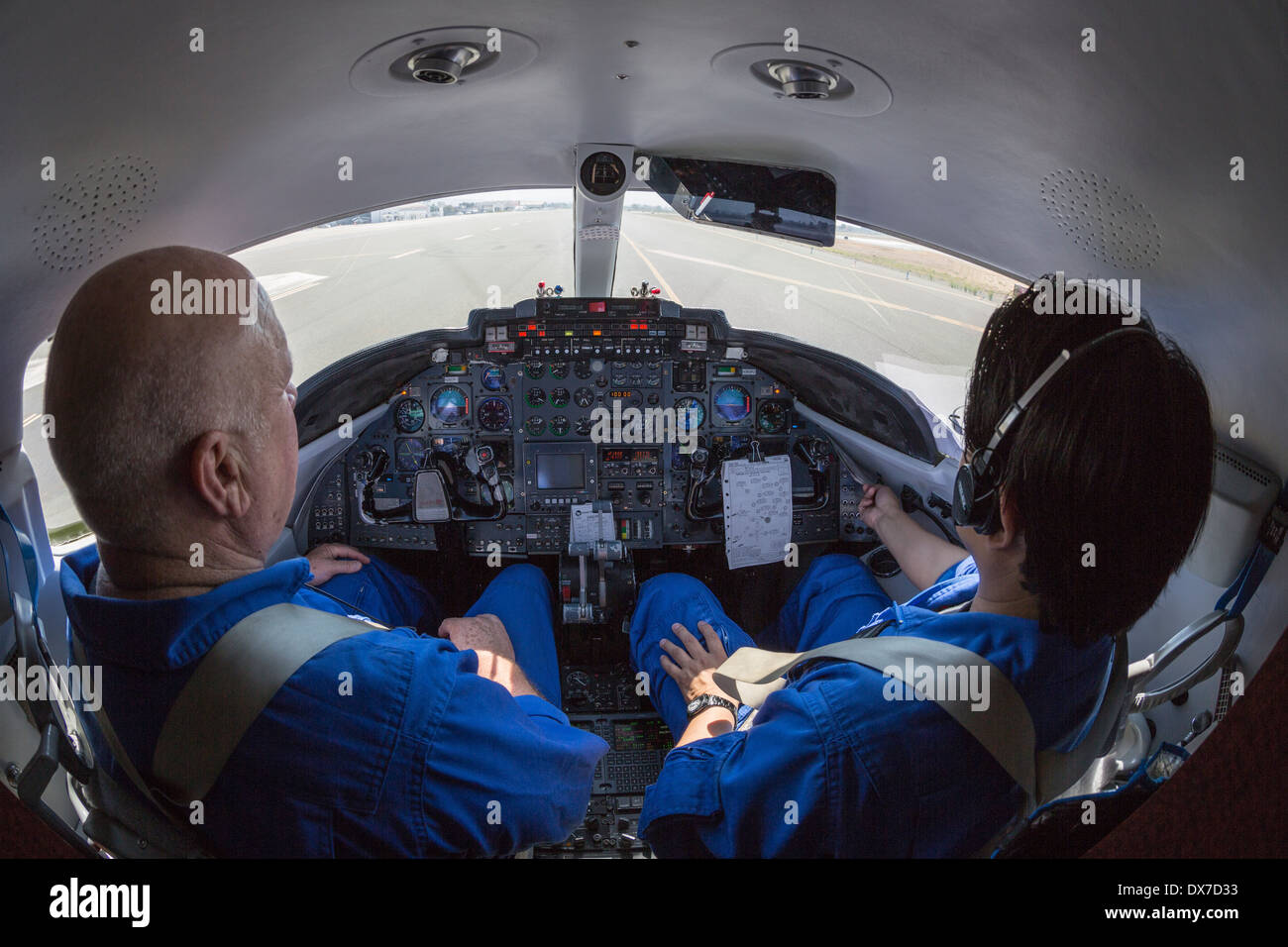 Private jet pilots taxi for take-off at Portland, Oregon airport - Stock Image