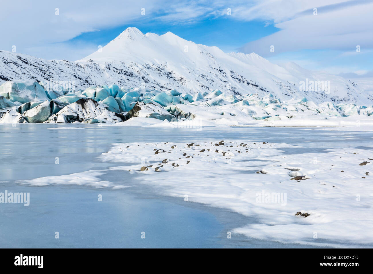 The aqua blue tongue of Heinabergs glacier and frozen glacial lagoon in Southeast Iceland near Hofn - Stock Image