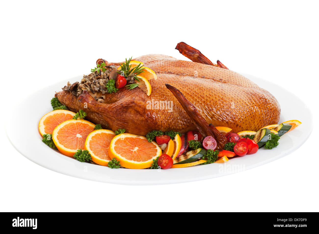 Roasted duck on a plate with salads oranges and vegetables,on a white background. - Stock Image