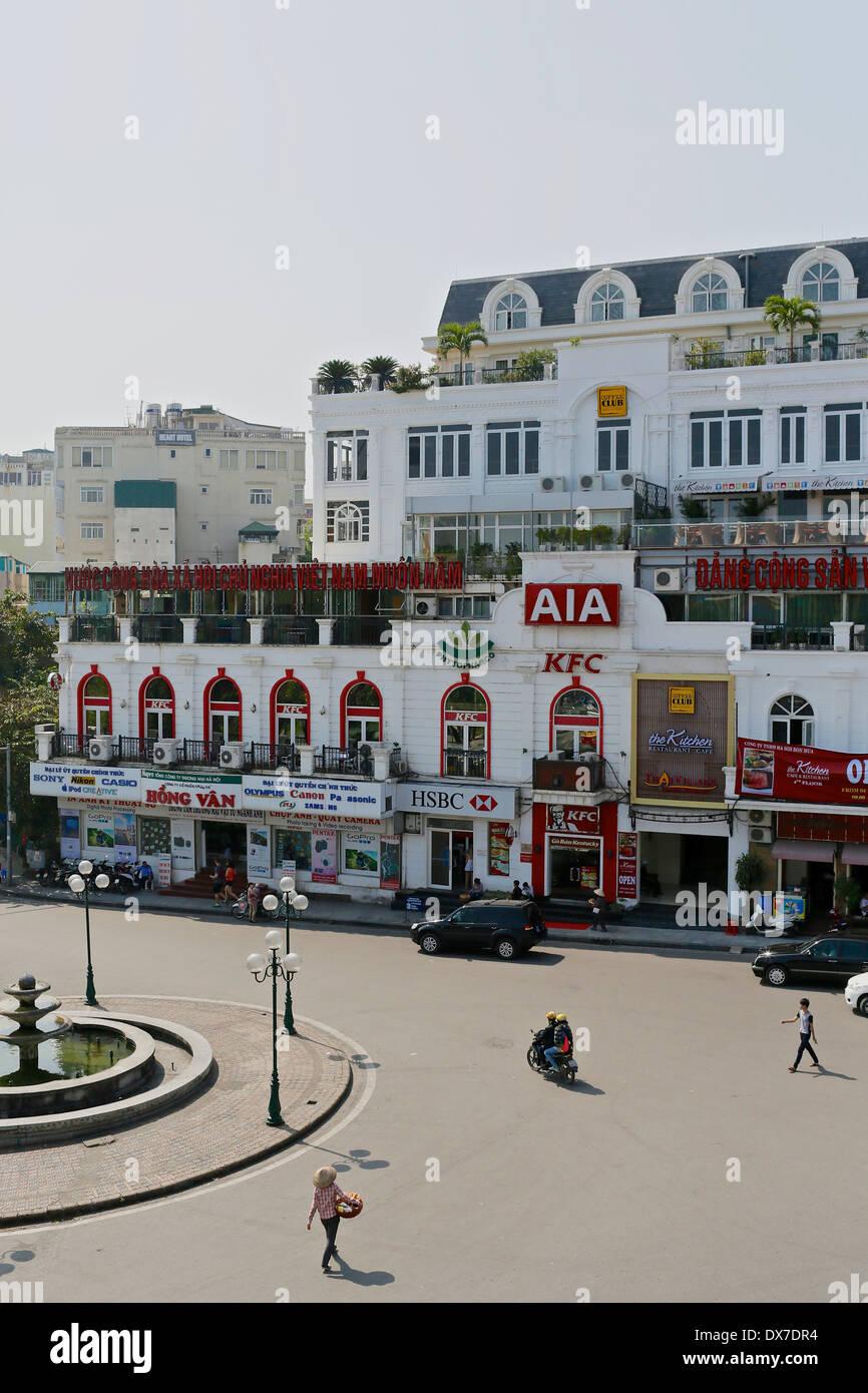 Modern consumer goods, fast food restaurants, cafes and banks begin to encroach on Hanoi's old quarter. Hanoi, Vietnam, - Stock Image