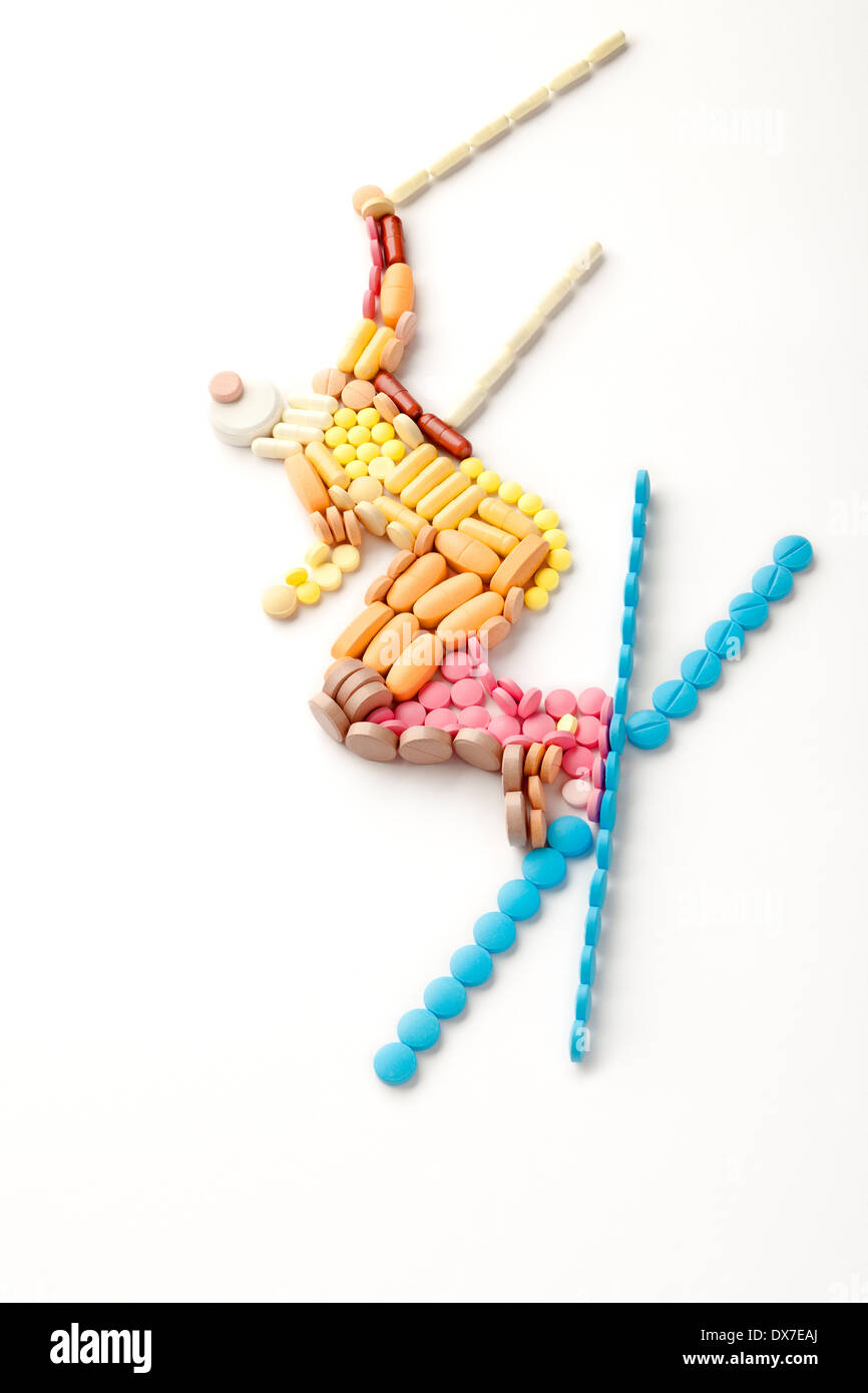 Doping pills and drugs in the shape of a winter jumping skier. - Stock Image