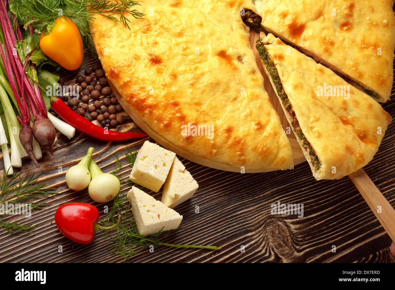 A colourful photo of beet osetinian pie. - Stock Image