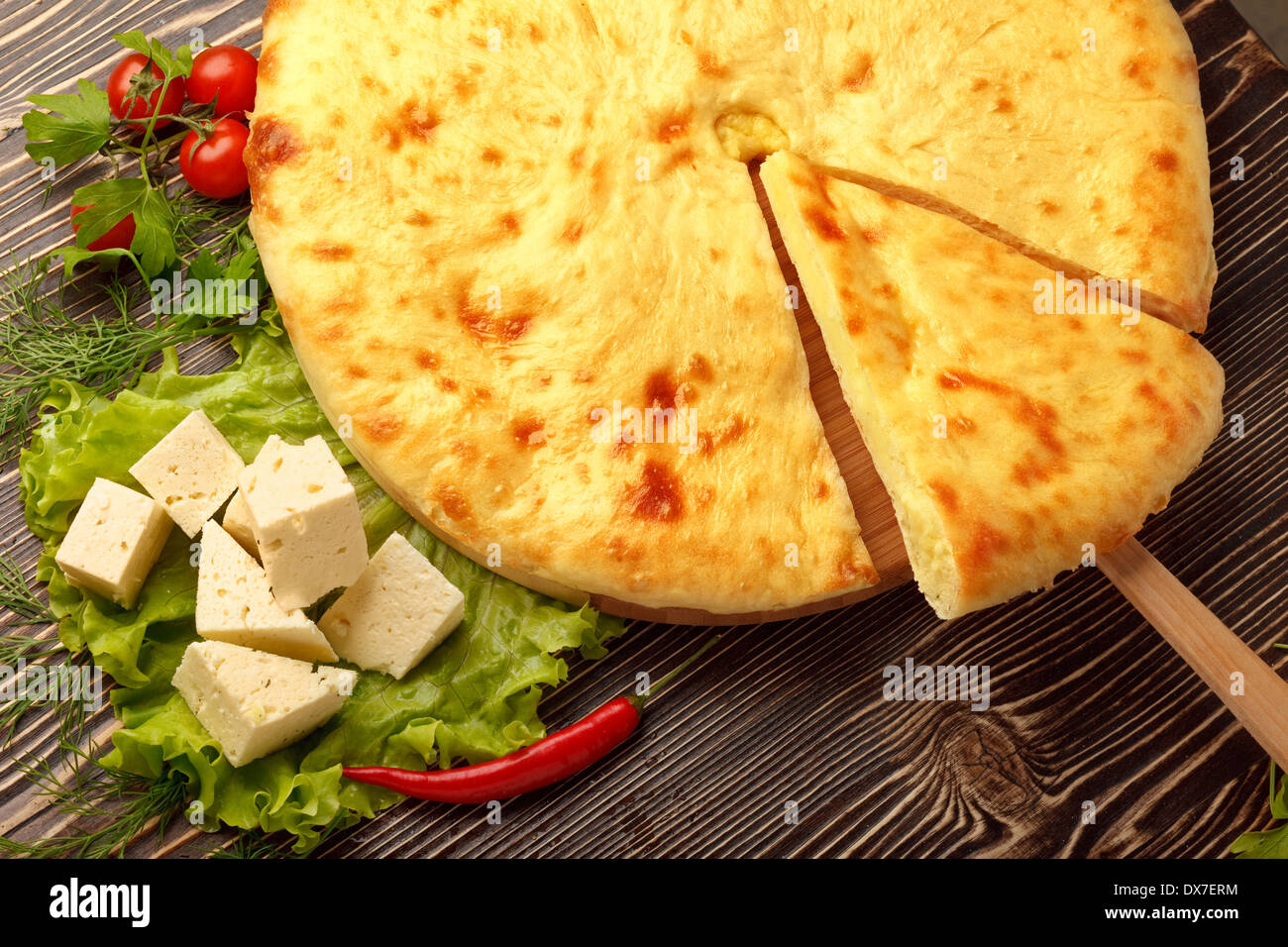 Traditional Ossetian feta cheese pie still life. - Stock Image
