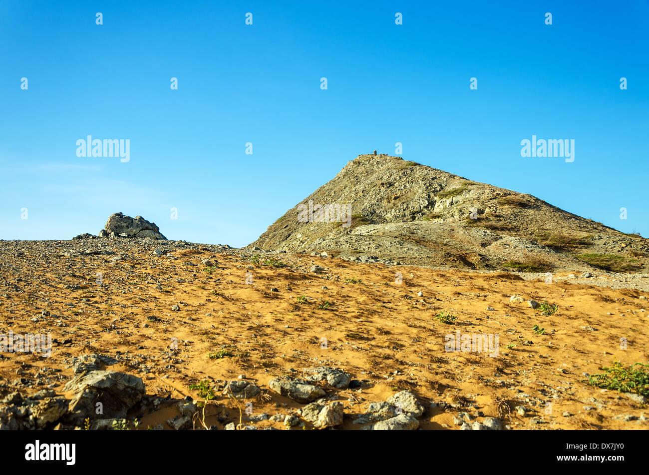 Pilon de Azucar hill rising above a dry barren desert in La Guajira, Colombia - Stock Image
