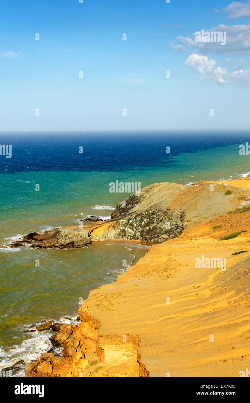View of a dry desert coastline and the Caribbean Sea with various shades of blue near Cabo de la Vela in La Guajira, Colombia - Stock Image