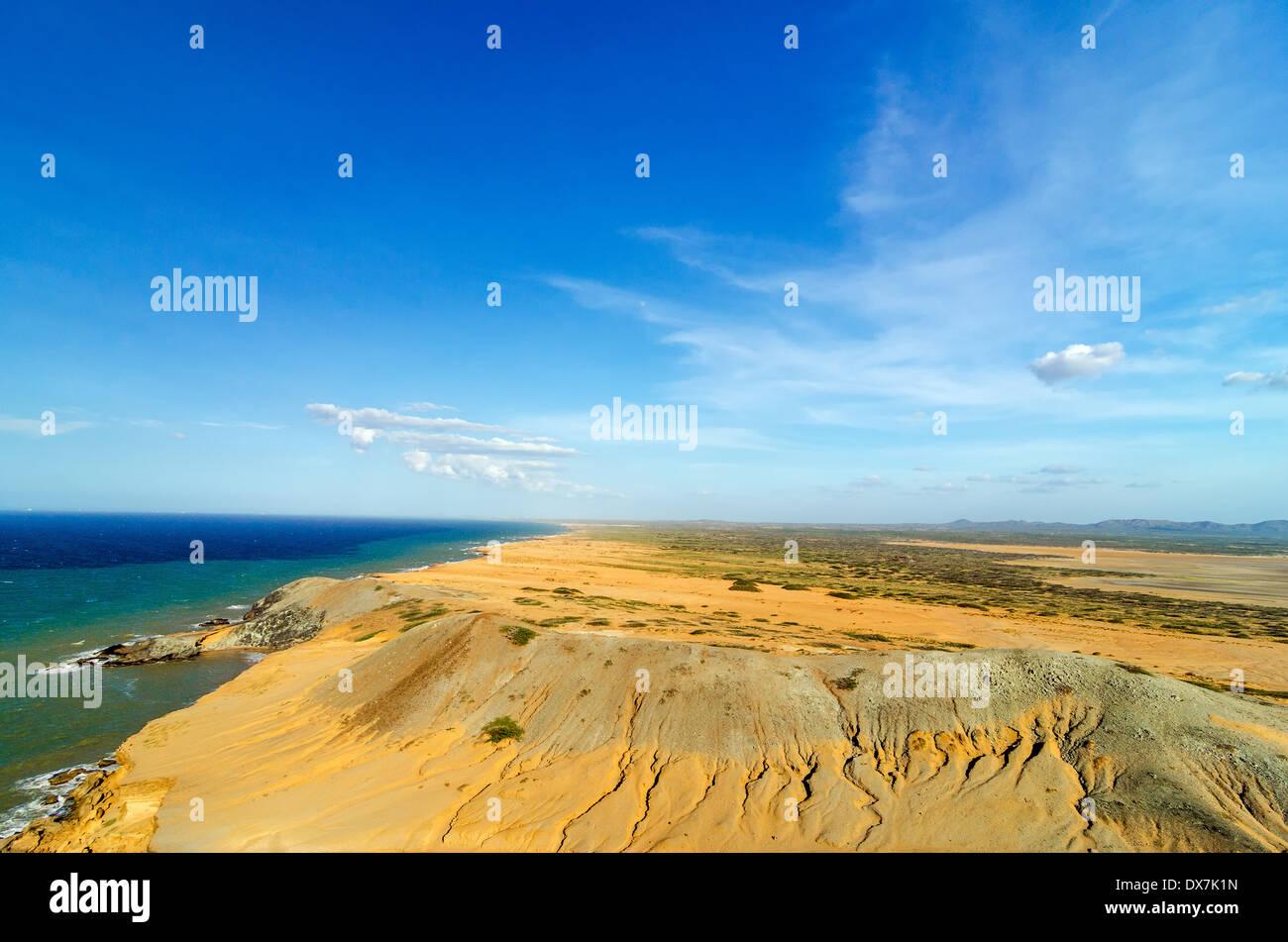 Dry desert coastal landscape next to Caribbean Sea in La Guajira, Colombia - Stock Image