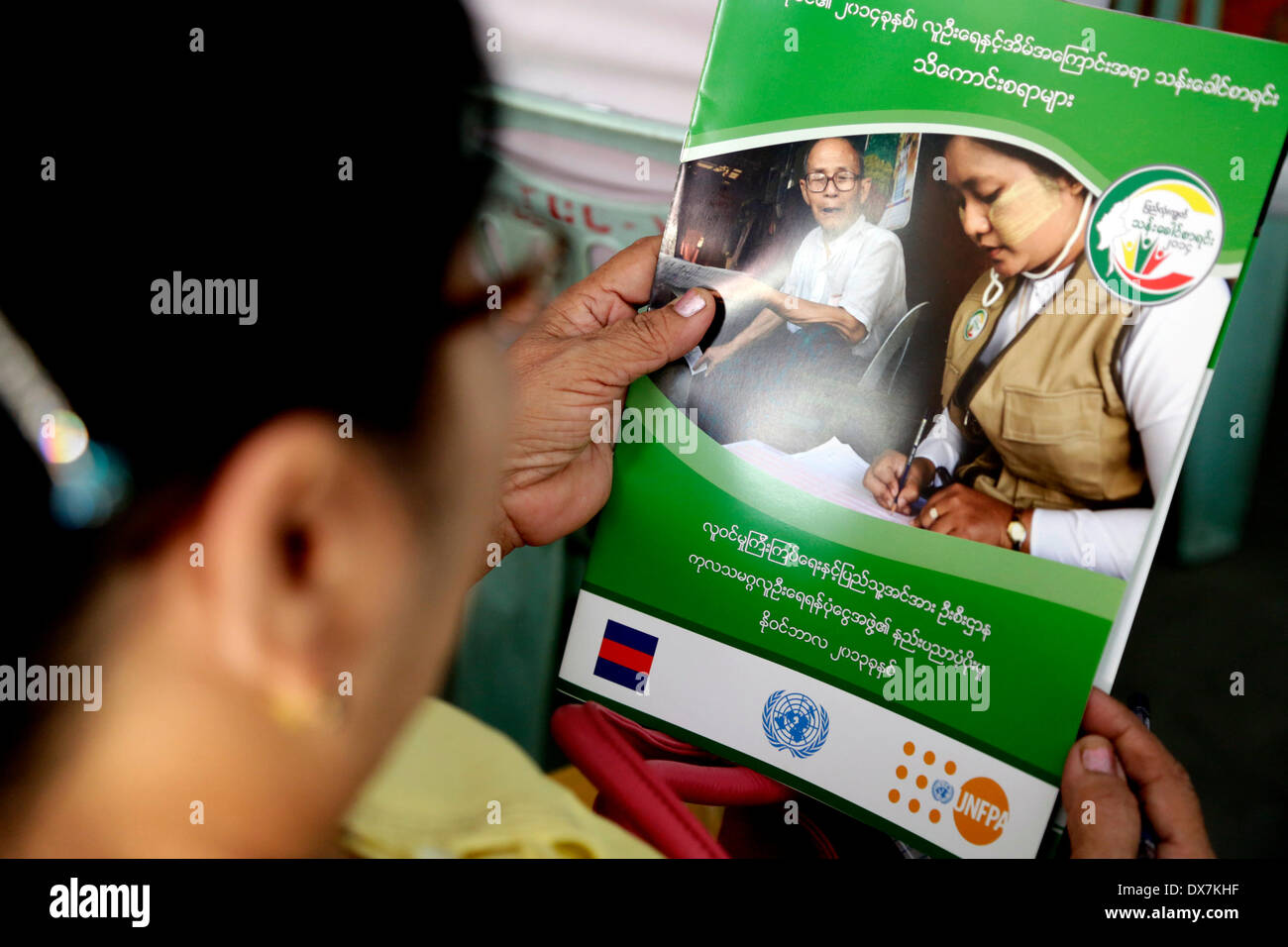 Yangon, March 20. 10th Apr, 2014. An enumerator for 2014 national census reads a brochure during the training course in enumeration techniques in Yangon, Myanmar, March 20, 2014. The 12-day census using a work force of 120,000 will be carried out from March 30 to April 10, 2014. © U Aung/Xinhua/Alamy Live News - Stock Image