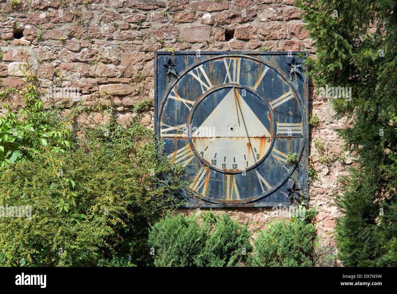 sunny scenery including a old weathered sundial in Southern Germany - Stock Image