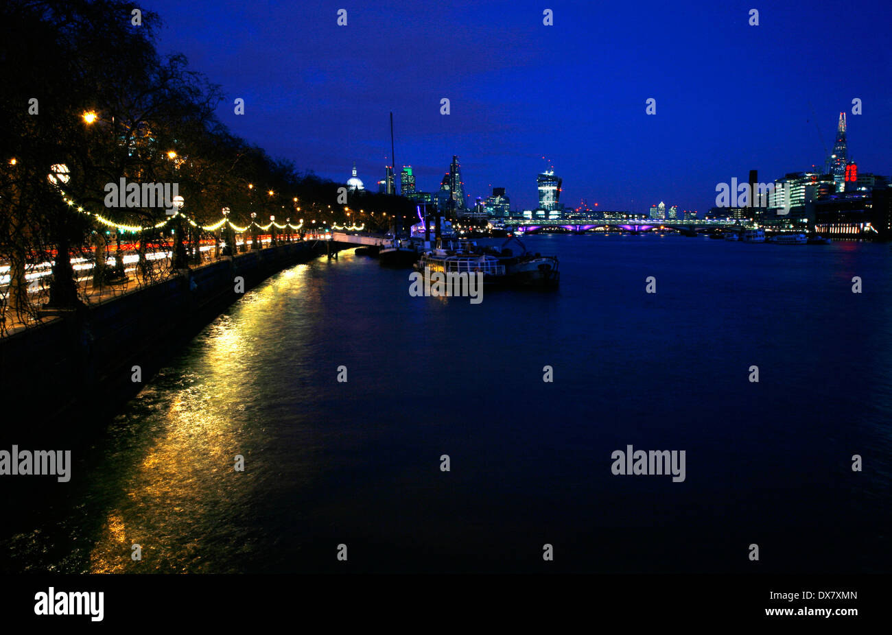 View from Victoria Embankment down the River Thames to Blackfriars Bridge and the City of London beyond, London, UK - Stock Image