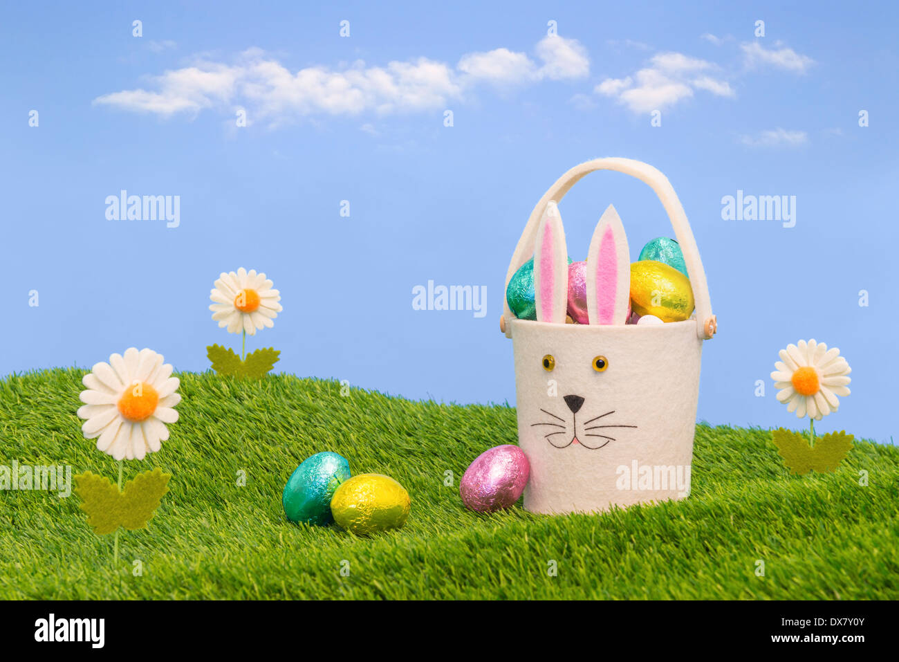 Easter basket full of foil wrapped chocolate eggs. Stock Photo