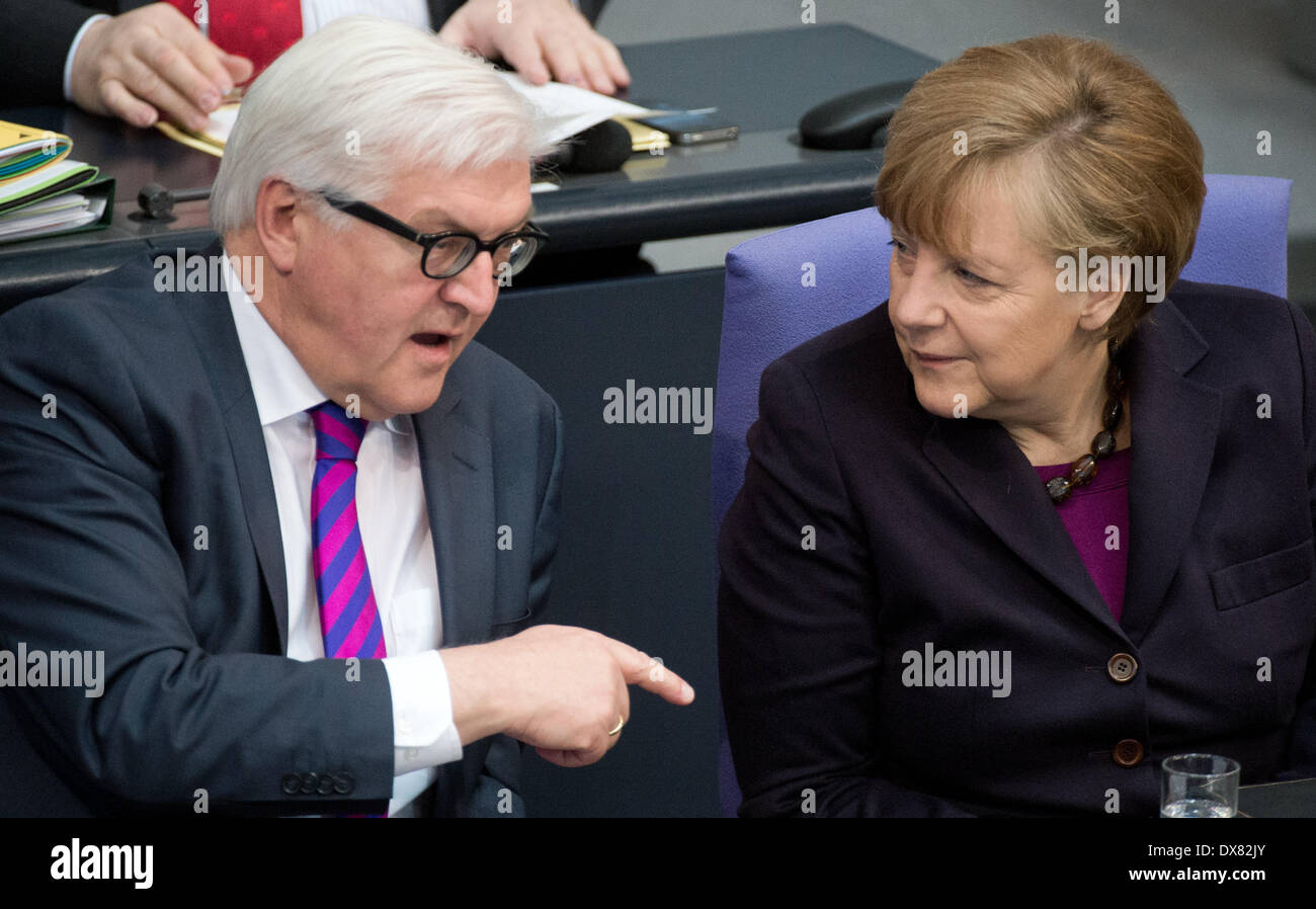 Berlin, Germany. 20th Mar, 2014. German Chancellor Angela Merkel and Foreign Minister Frank-Walter Steinmeier speak during a session of parliament in the German Bundestag in Berlin, Germany, 20 March 2014. The Bundestag will be debating the planned EU sanctions in the Crimean crisis, liability insurance for midwives and the introduction of an investigation committee on the NSA scandal. Photo: BERND VON JUTRCZENKA/dpa/Alamy Live News/Alamy Live News - Stock Image
