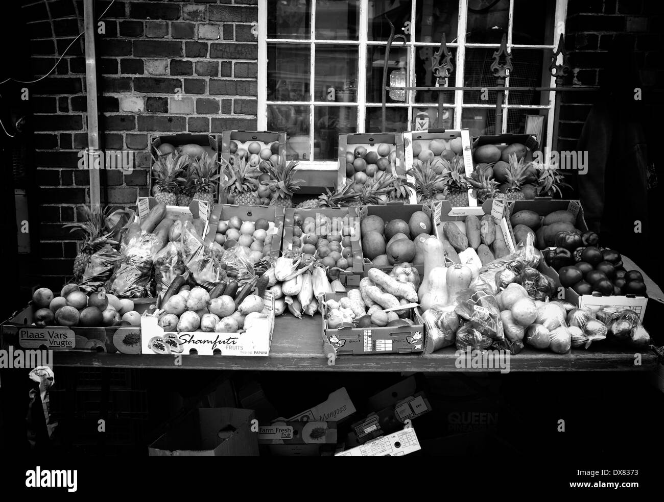 Black and white photograph of assortment of fresh fruits and vegetables for sale at Kalk Bay, near Cape Town. - Stock Image