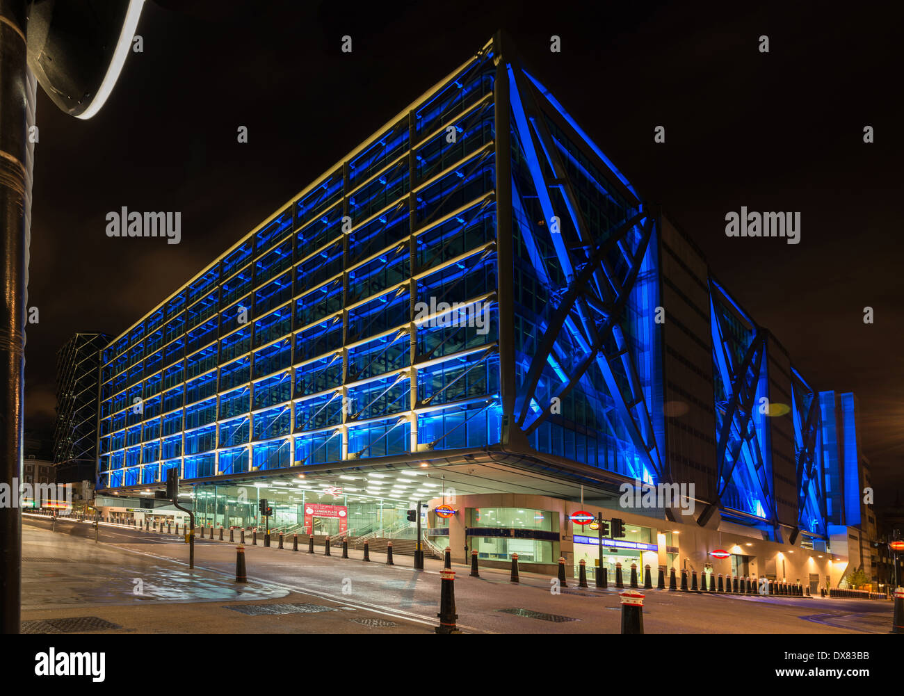 Cannon Street Station, railway terminus, London Underground and offices, at night, lit in electric blue in the City of London - Stock Image
