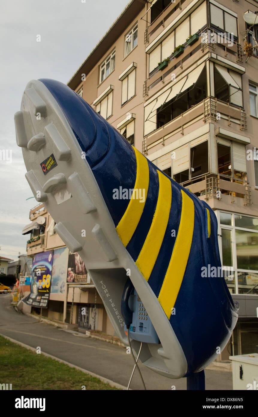 Football Boot Shaped Public Telephone Istanbul - Stock Image