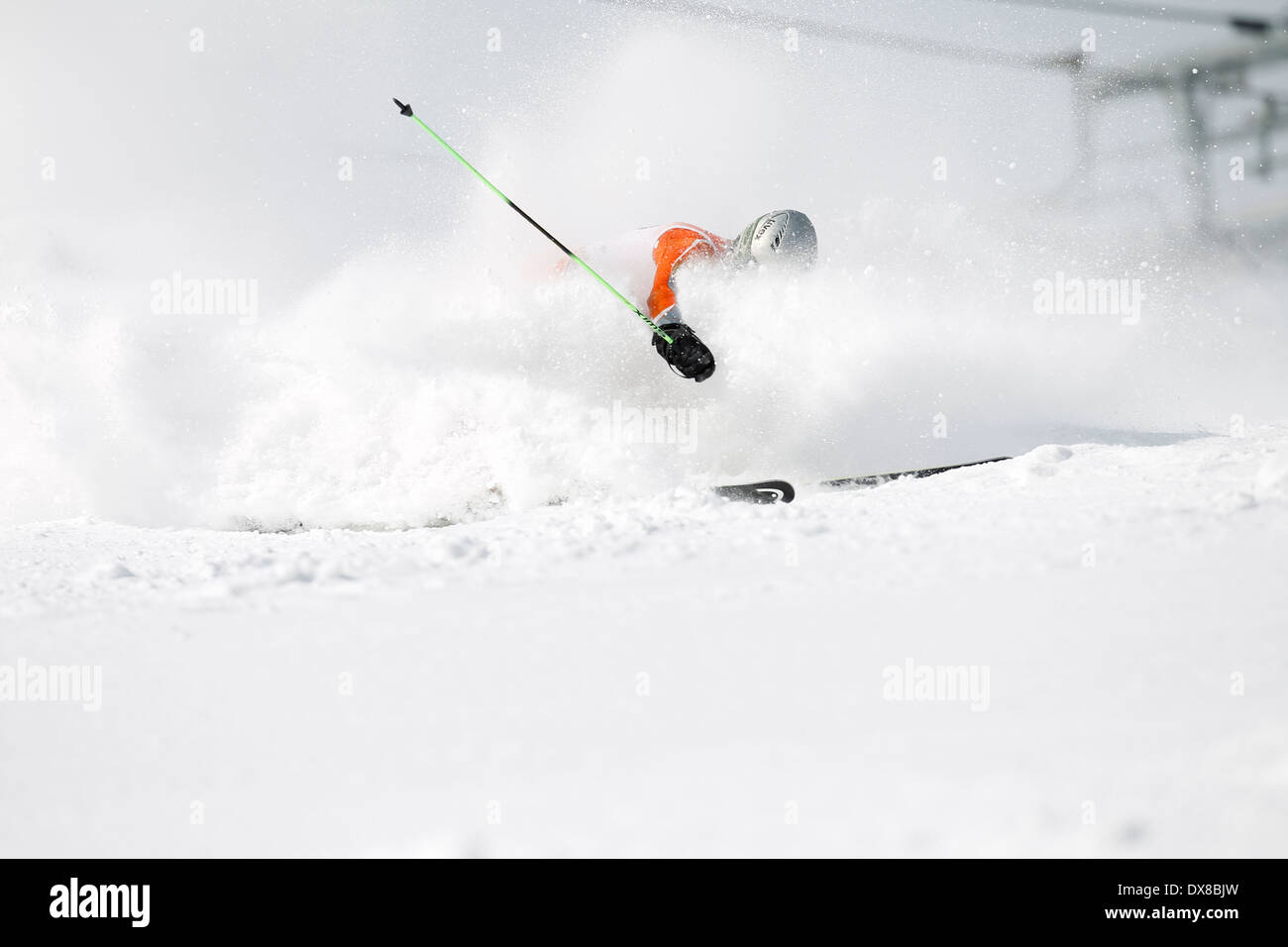 An alpine ski racer out of control on the giant slalom course. - Stock Image