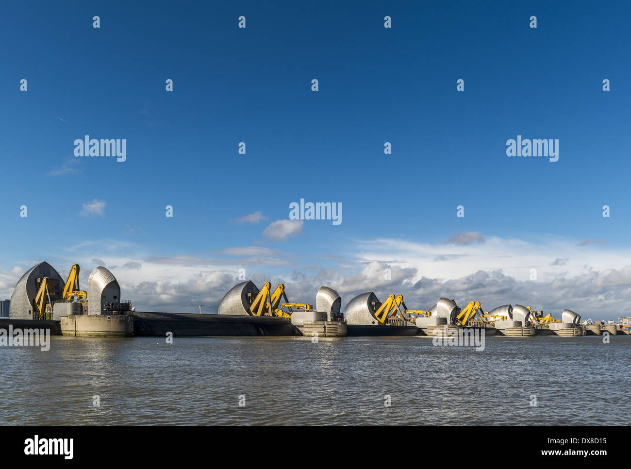 Shown here in the raised position, the Thames Barrier is located downstream of central London, United Kingdom, operational - Stock Image