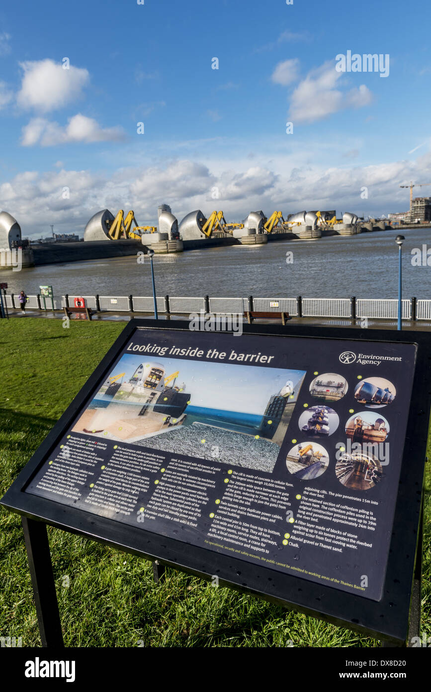 Looking inside the barrier: a sign that explains the workings of the Thames Flood Barrier, shown here in the raised position in - Stock Image