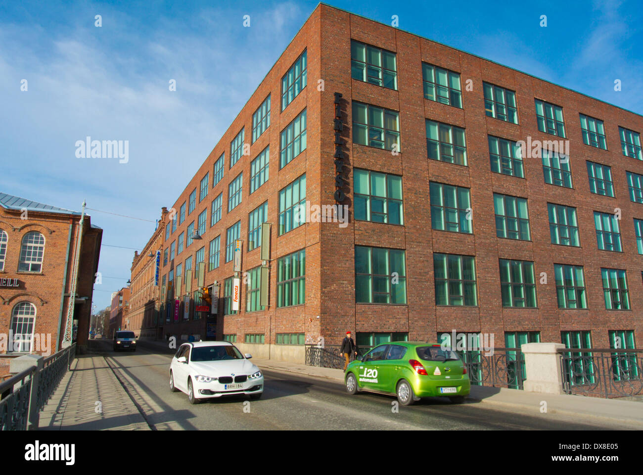 Satakunnankatu street going past Finlayson, converted former industrial buildings by Tammerkoski river, central Tampere - Stock Image