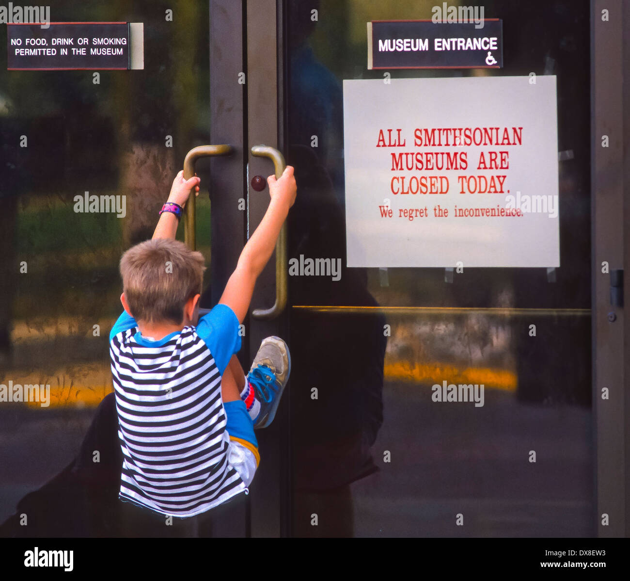 WASHINGTON, DC - Federal Government shutdown October 8, 1990. Young tourist attempts to enter locked Smithsonian Air and Space - Stock Image