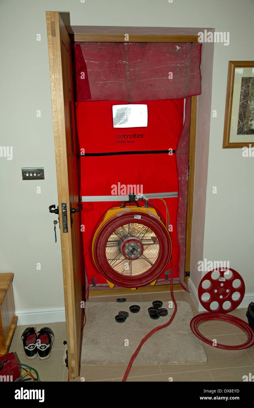 Air test fan installed in front door opening testing airtightness leakage new self build UK - Stock Image