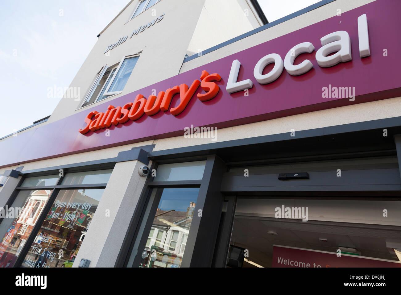 Sainsbury Local shop signage exterior. - Stock Image