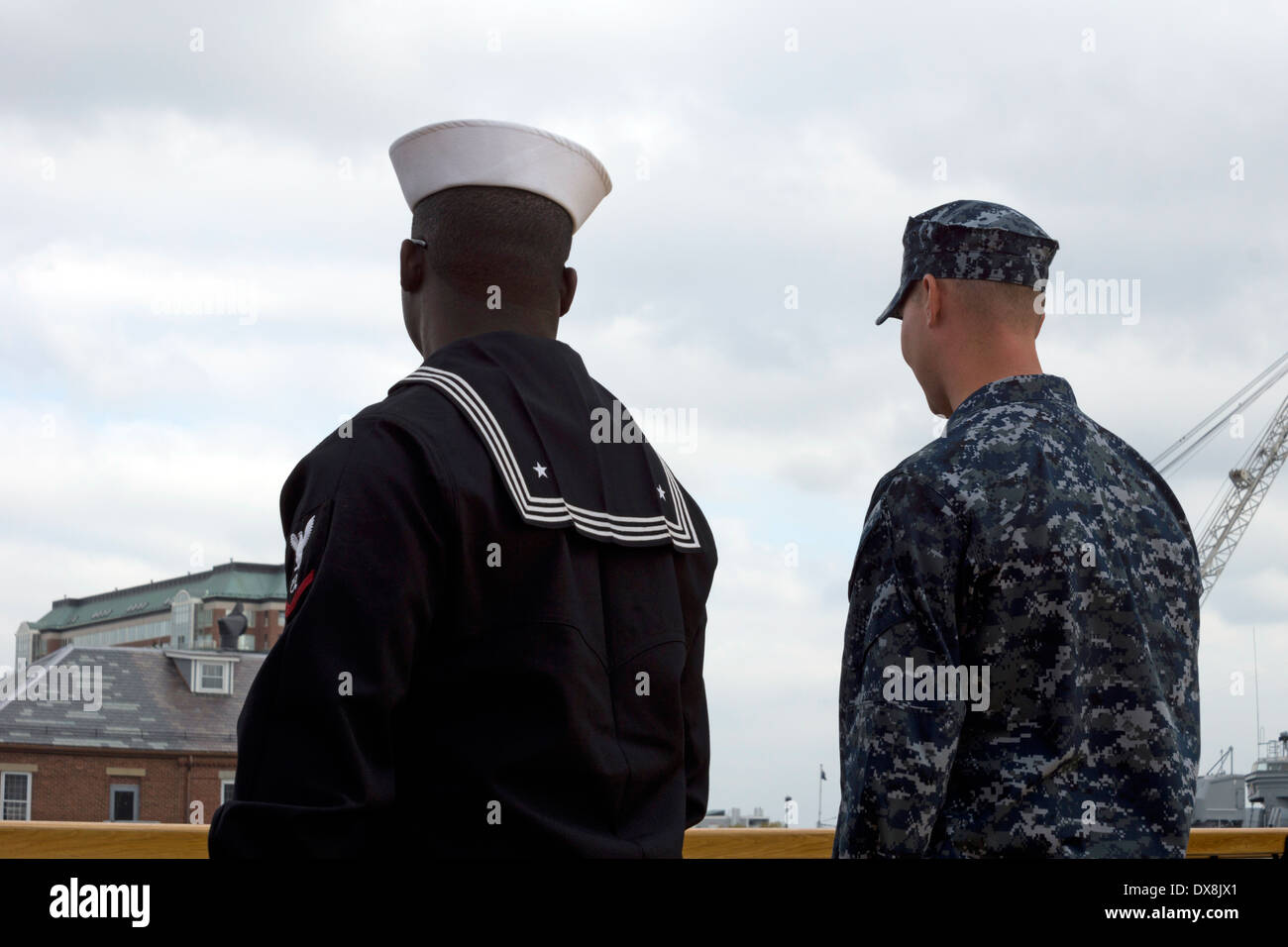 Back view of two American sailors, one in dress uniform, one in working uniform, at Charlestown Navy Yard, Boston, Stock Photo
