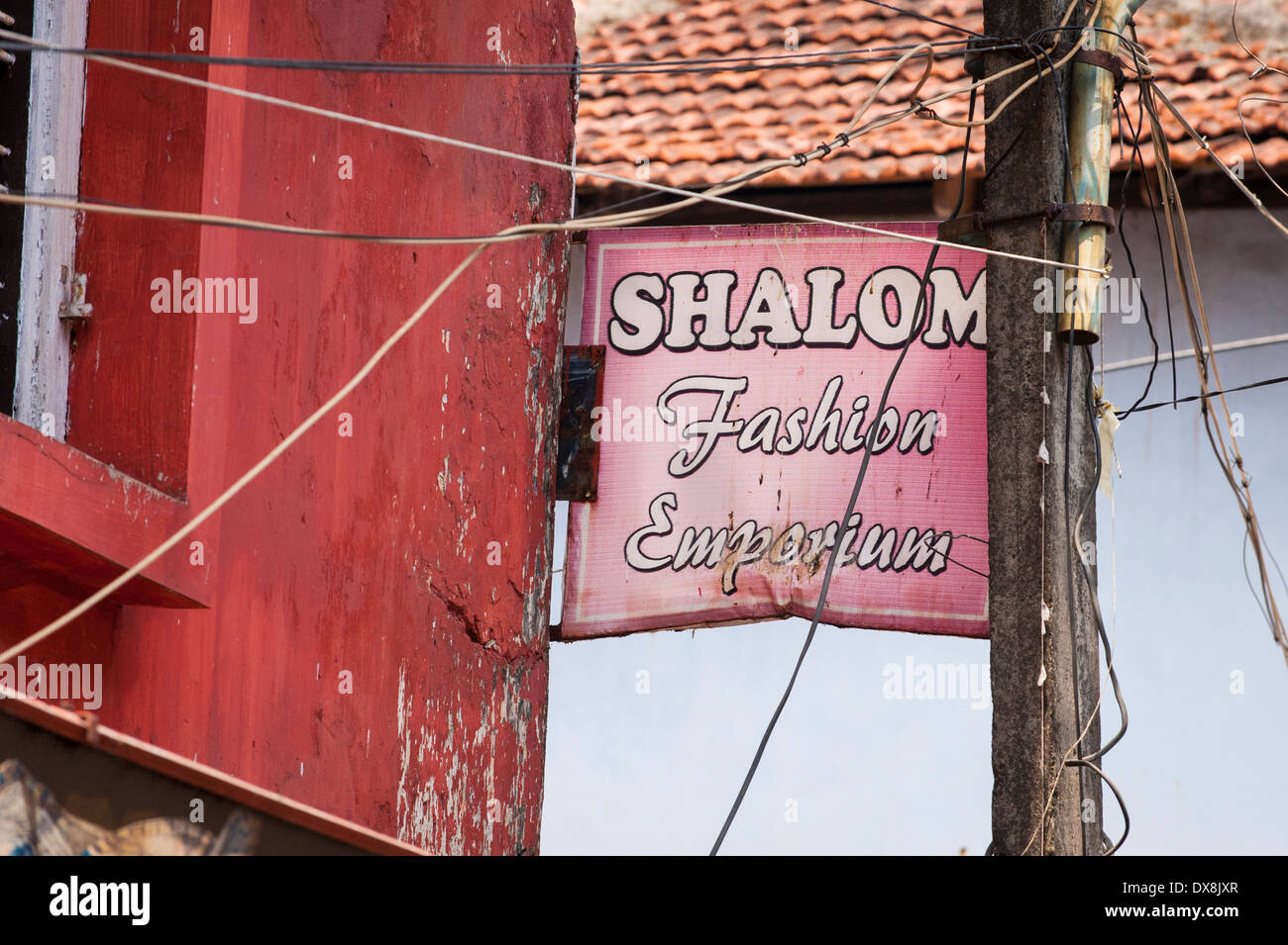South Southern India Kerala Cochin Kochi Jew Town Mattancherry street road sign signs Shalom Fashion Emporium shop store - Stock Image