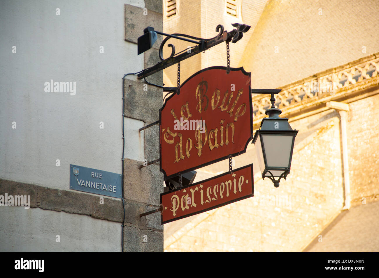 French patisserie sign with carriage lamp - Stock Image