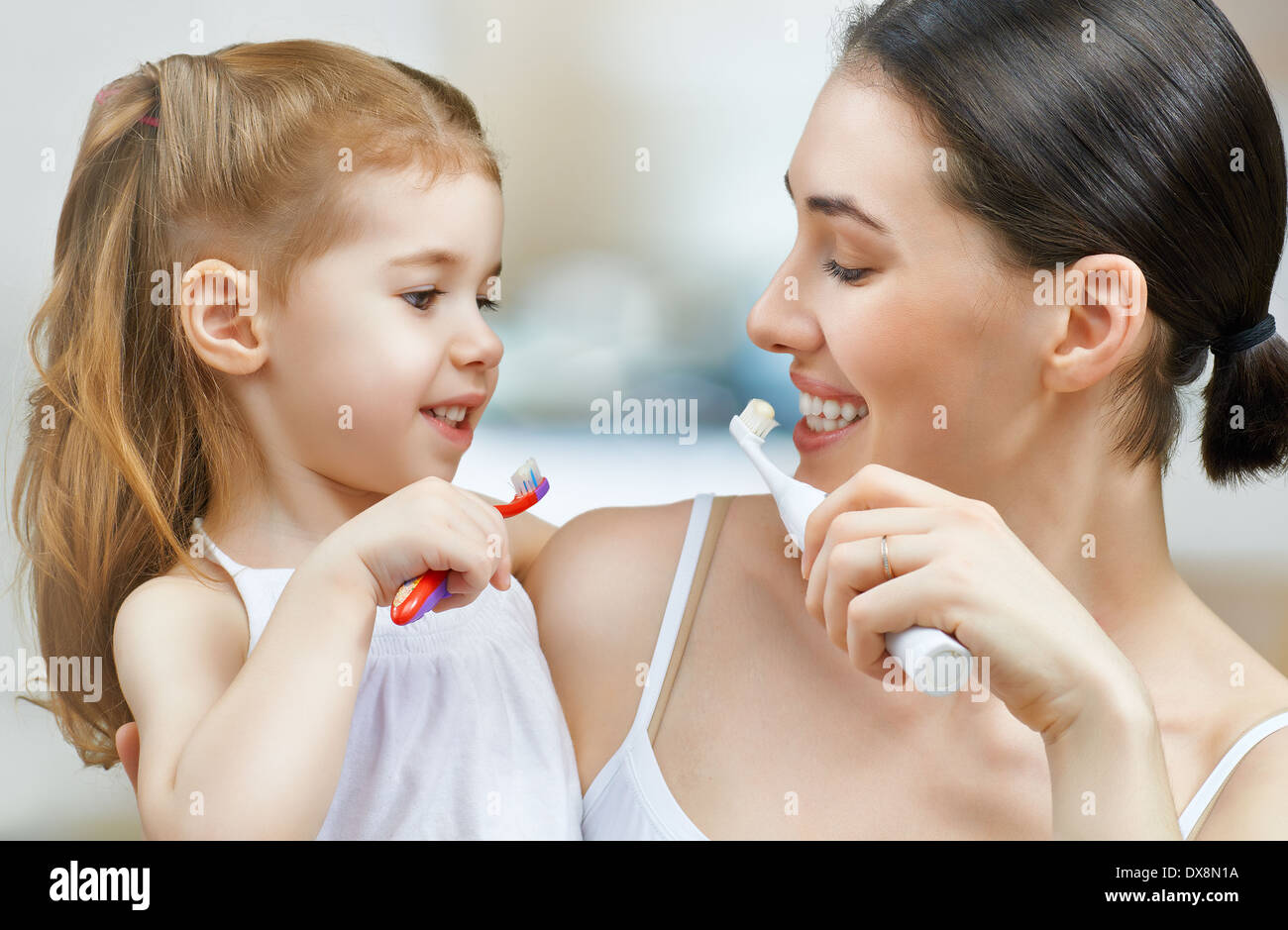 mother and daughter brush my teeth - Stock Image