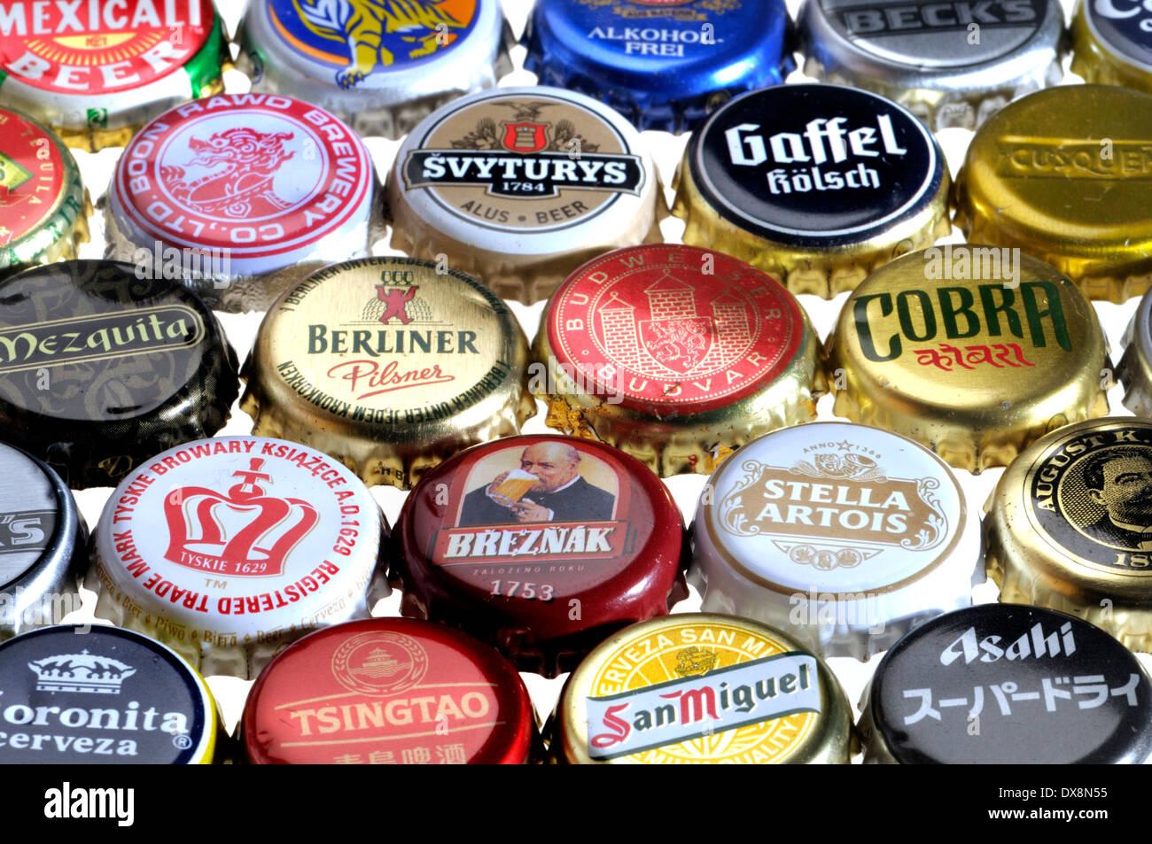 Beer bottle caps / crown corks. International beers - Stock Image