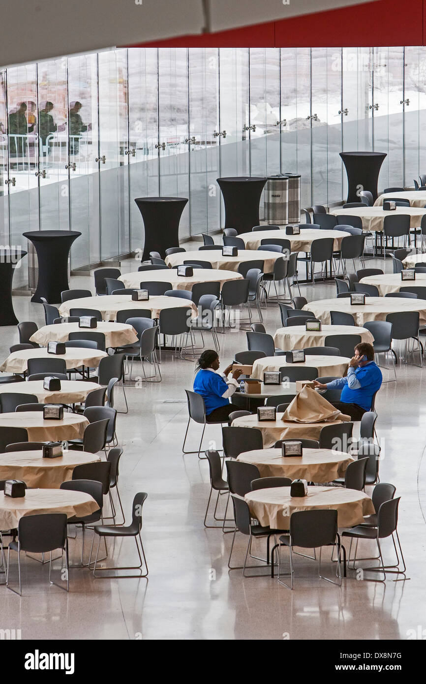 Detroit, Michigan - Two workers in a mostly-empty food court in Cobo Hall, Detroit's convention center. - Stock Image