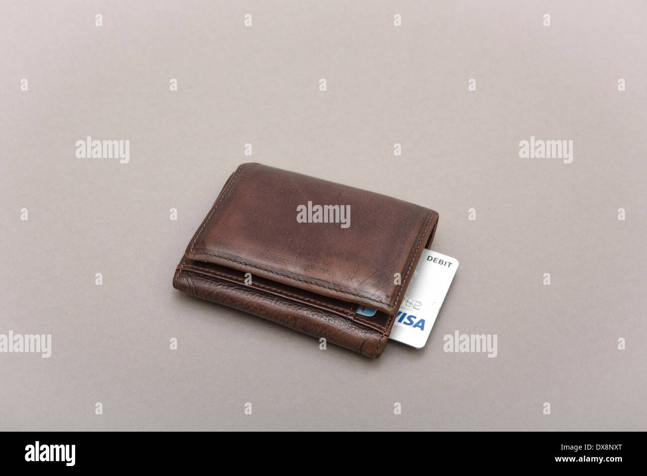 Brown leather wallet with visa card - Stock Image