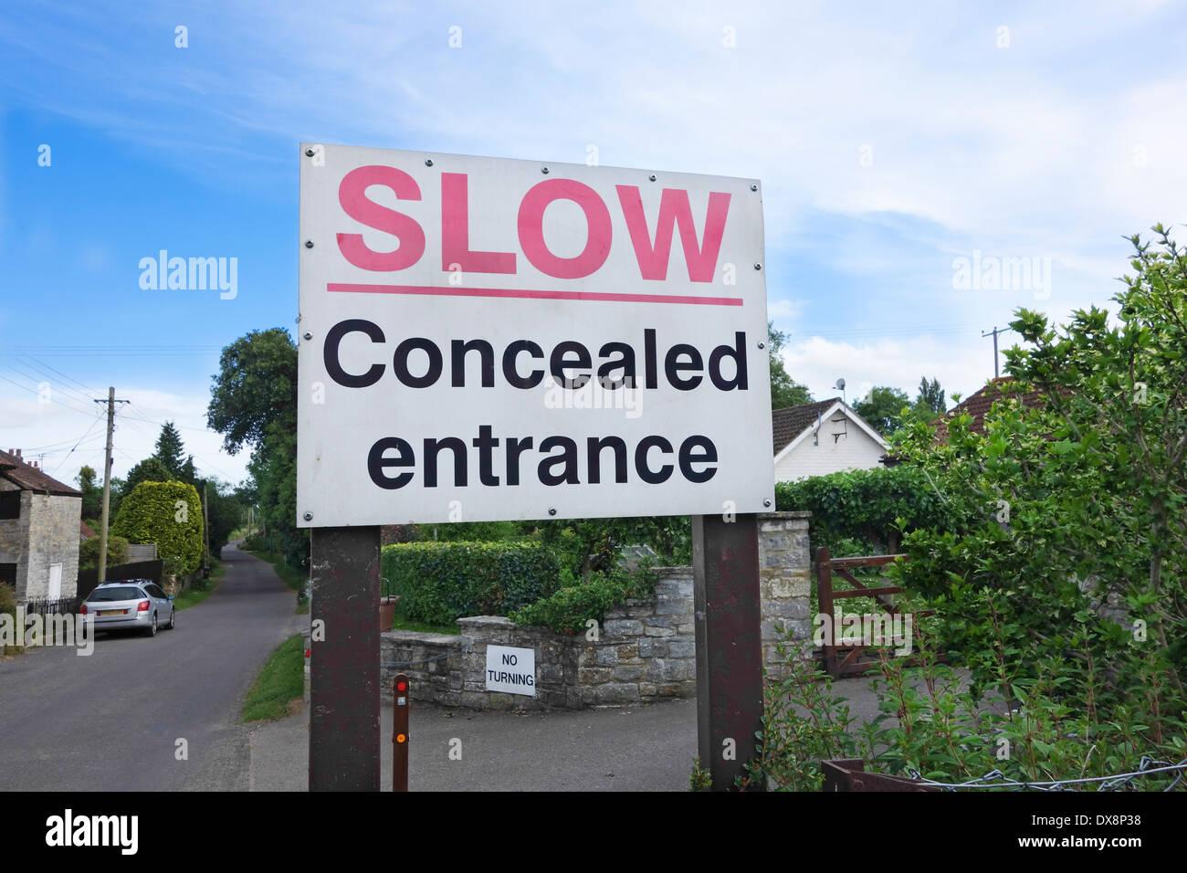 Road Sign Slow Concealed Entrance - Stock Image