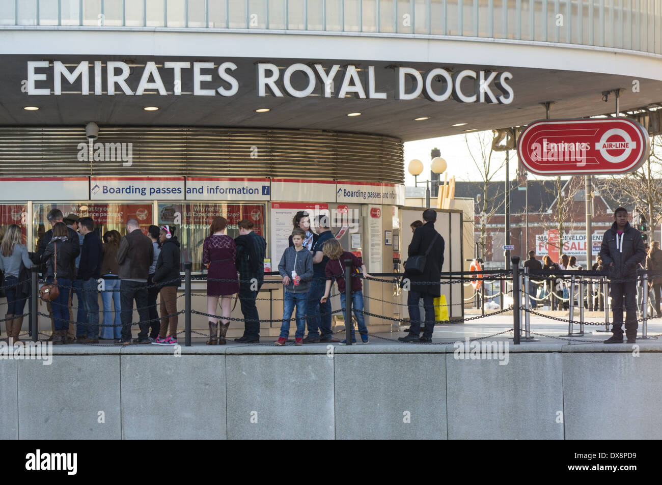 Passengers wait in queue at the Royal Docks cable car terminal, London England United Kingdom UK - Stock Image