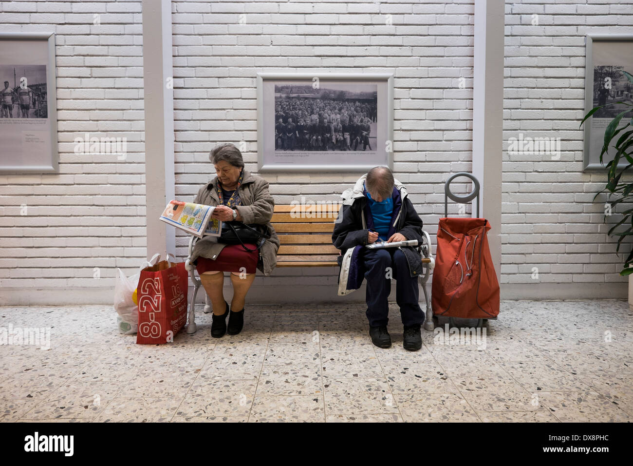 Two women reading a newspaper - Stock Image