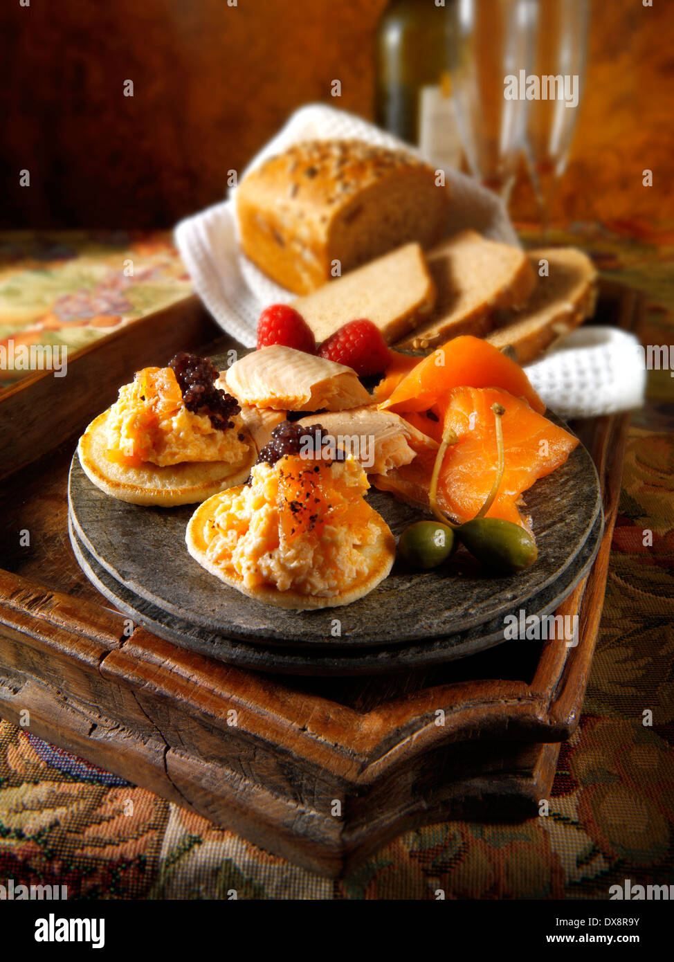 smoked salmon and scrambled egg on brown bread - Stock Image