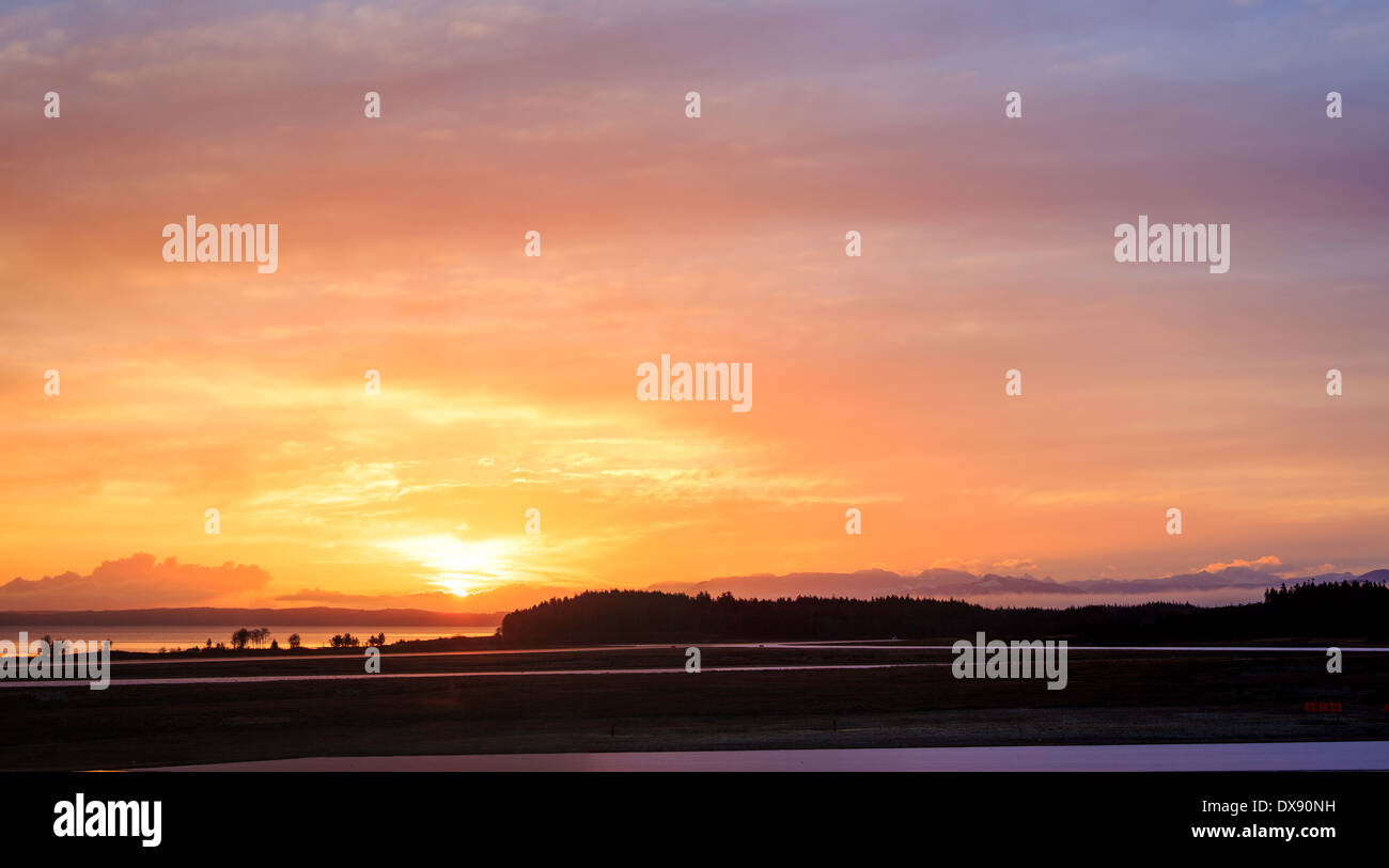 A panoramic sunrise photo at an airport. - Stock Image