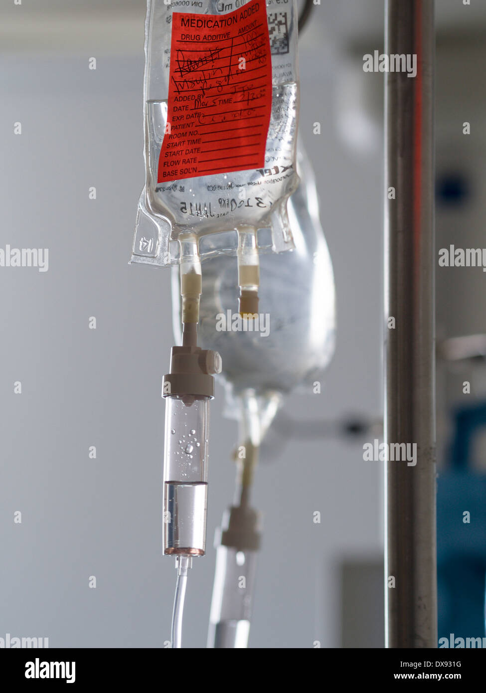 Insulin Intravenous Drip bag. A saline drip with added insulin hangs in a hospital ICU room. - Stock Image