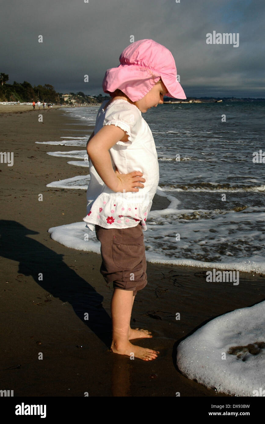 Little girl at surfline Stock Photo