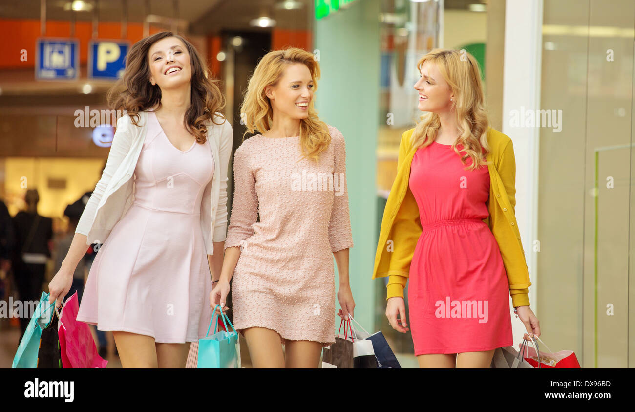 Group of female friends in the small shopping mall - Stock Image