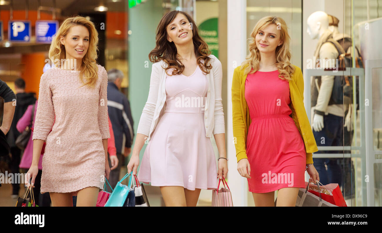 Three pretty ladies during the shopping day - Stock Image
