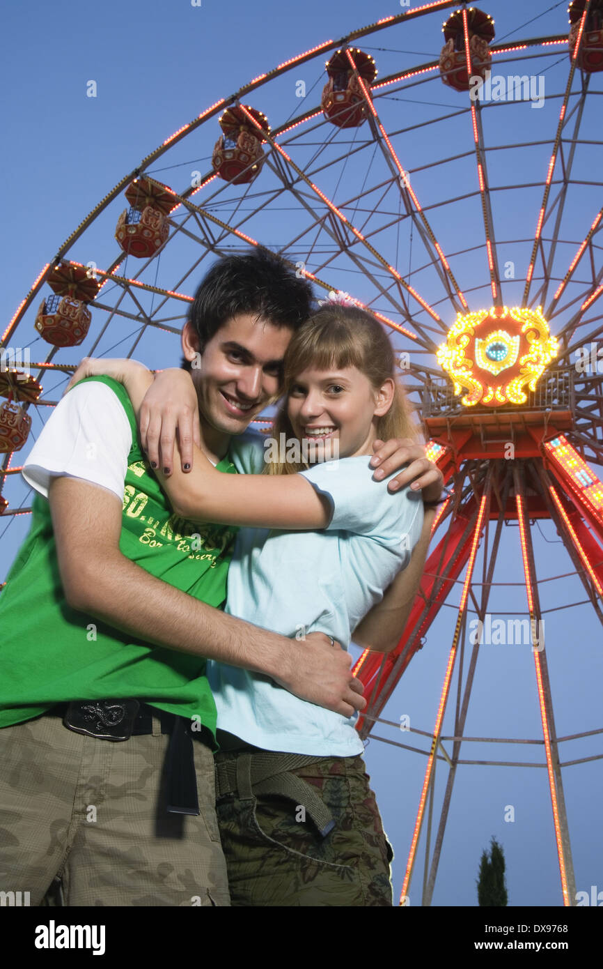 Teenage Couple At Ferris Wheel In Amusement Park Stock Photo Alamy