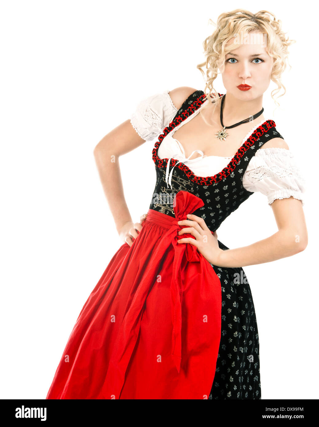 german woman in typical bavarian dress dirndl on white background. Oktoberfest - Stock Image