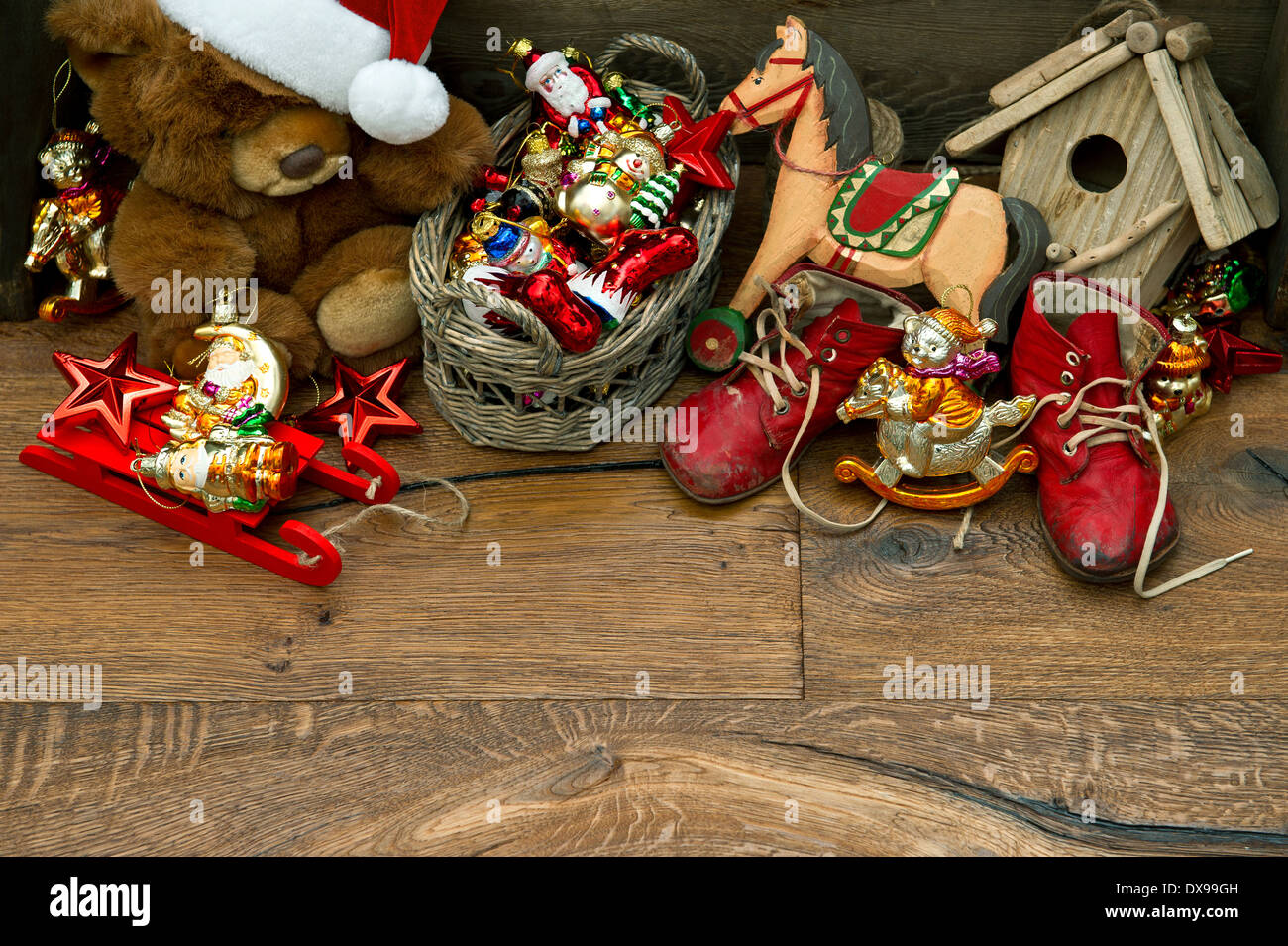 nostalgic christmas decoration with antique toys over wooden Stock ...
