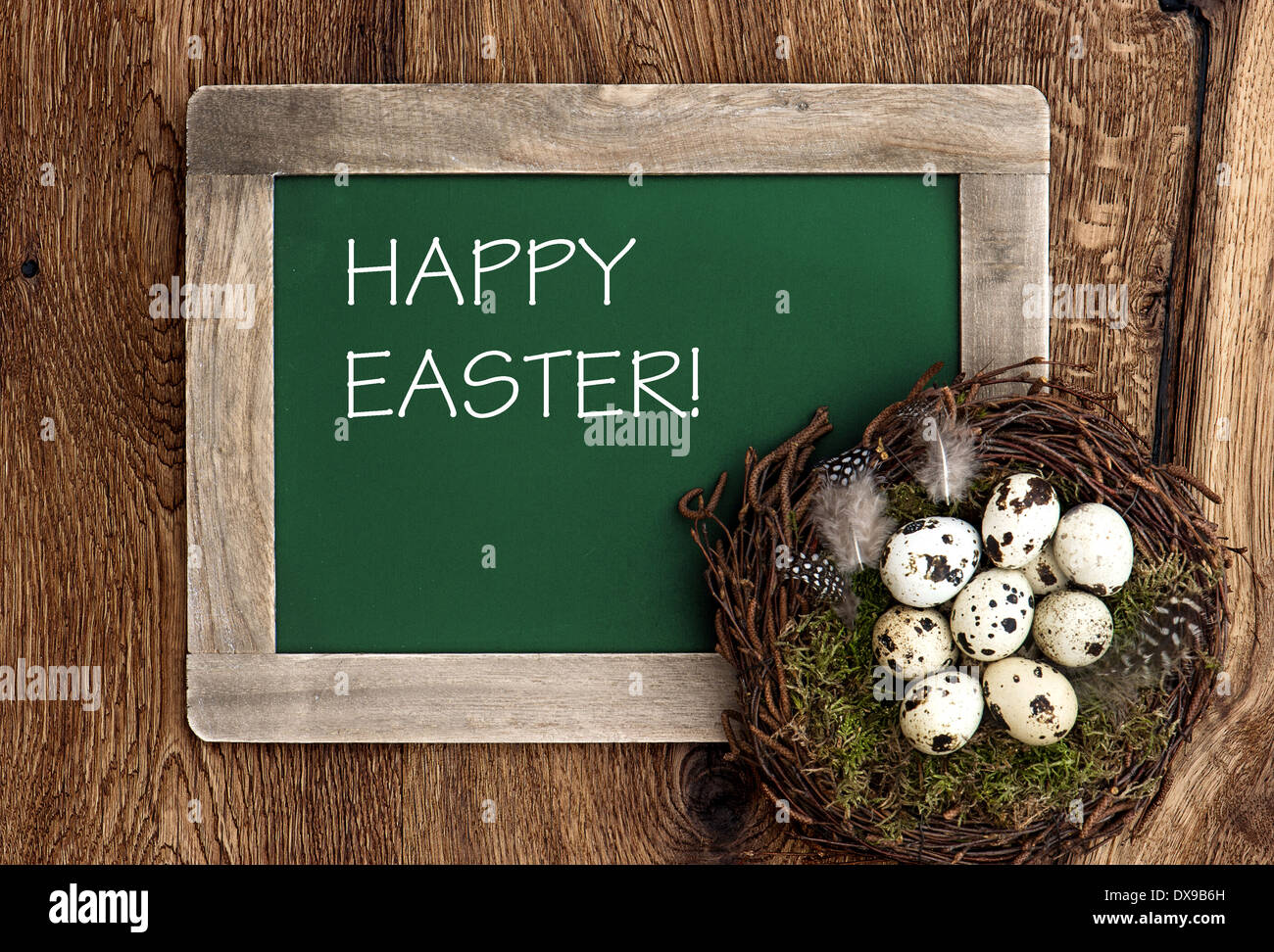 Birds Eggs In Nest And Vintage Blackboard On Rustic Wooden