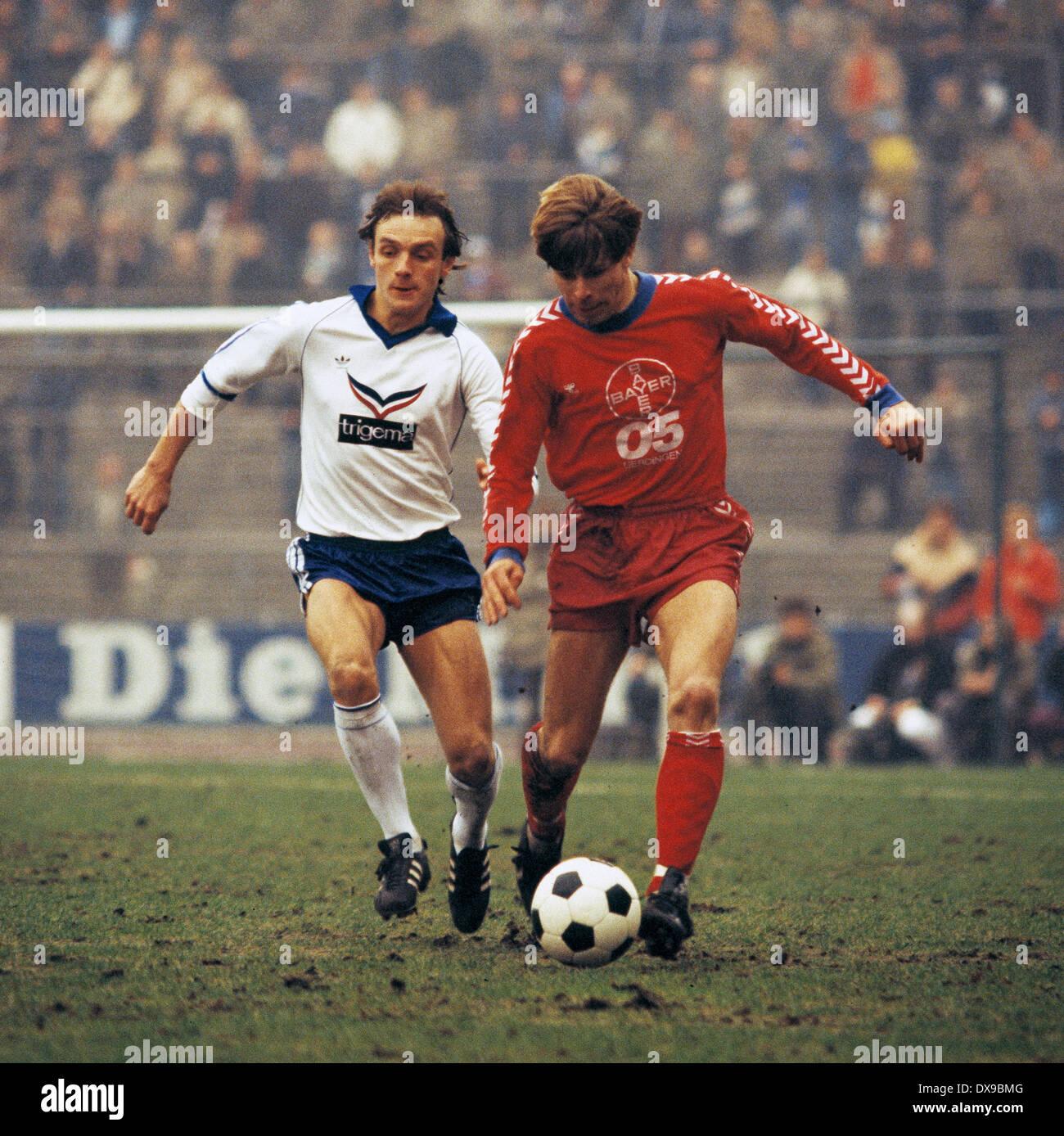 football, Bundesliga, 1979/1980, Parkstadion, FC Schalke 04 versus FC Bayer 05 Uerdingen 1:2, scene of the match, Ruediger Abramczik (S04) left and Norbert Brinkmann (Bayer) - Stock Image
