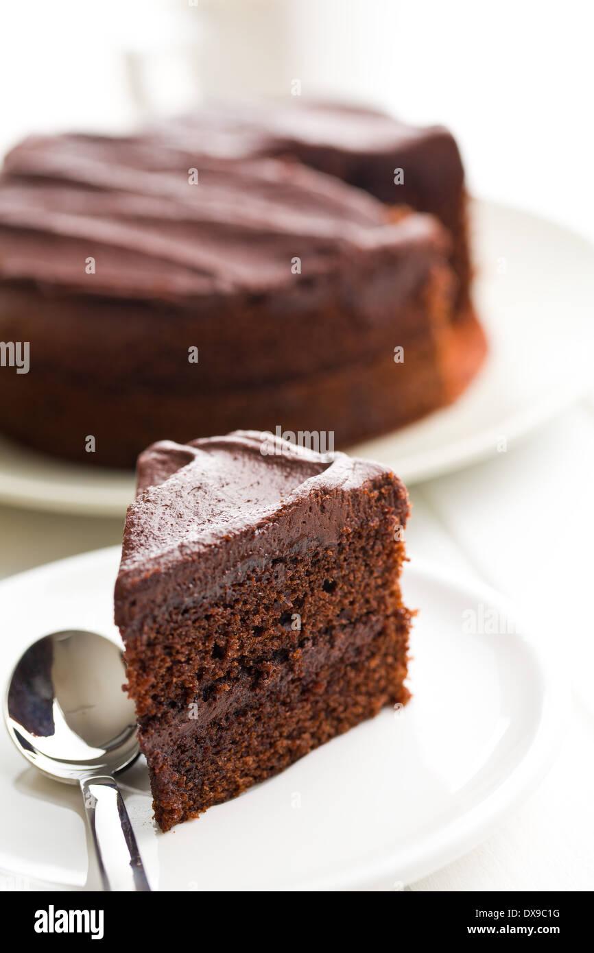 dark chocolate cake on plate - Stock Image