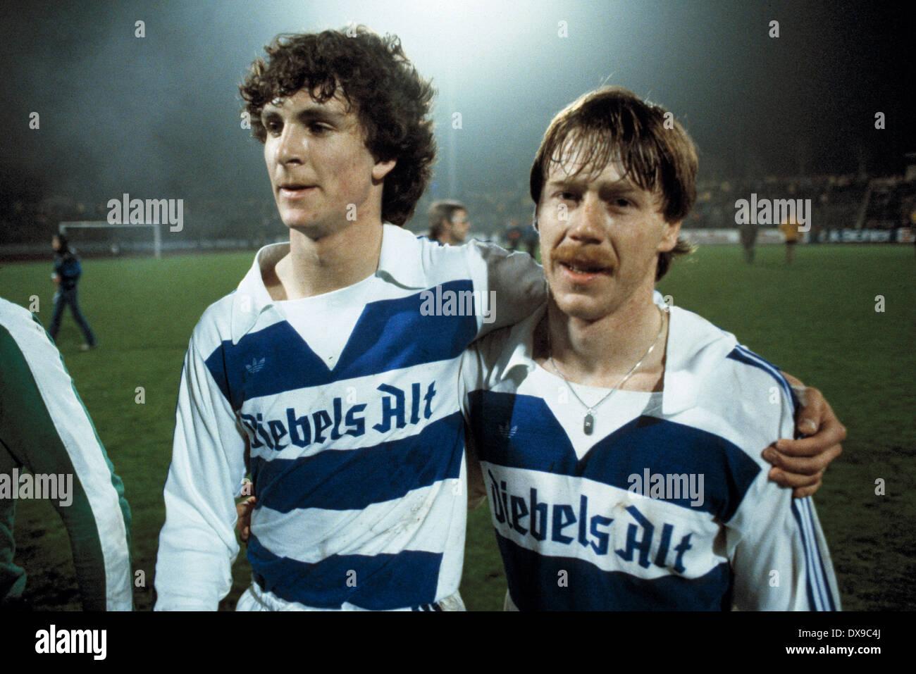 football, Bundesliga, 1979/1980, Wedau Stadium, MSV Duisburg versus SV Werder Bremen 4:1, end of the game, leaving, rejoicing at the win, Thomas Kempe (MSV) left and Gregor Grillemeier (MSV) - Stock Image